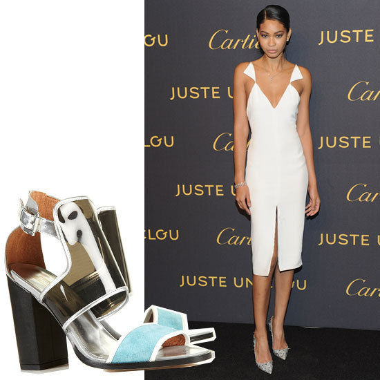 Chanel Iman kept it sleek in a white geo-cutout Cushnie et Ochs. To play up the edgier look of this dress without taking away from its unique silhouette, opt for a pop of color via bright heels. We chose a PVC-infused pair to complement the more futuristic look of the dress.