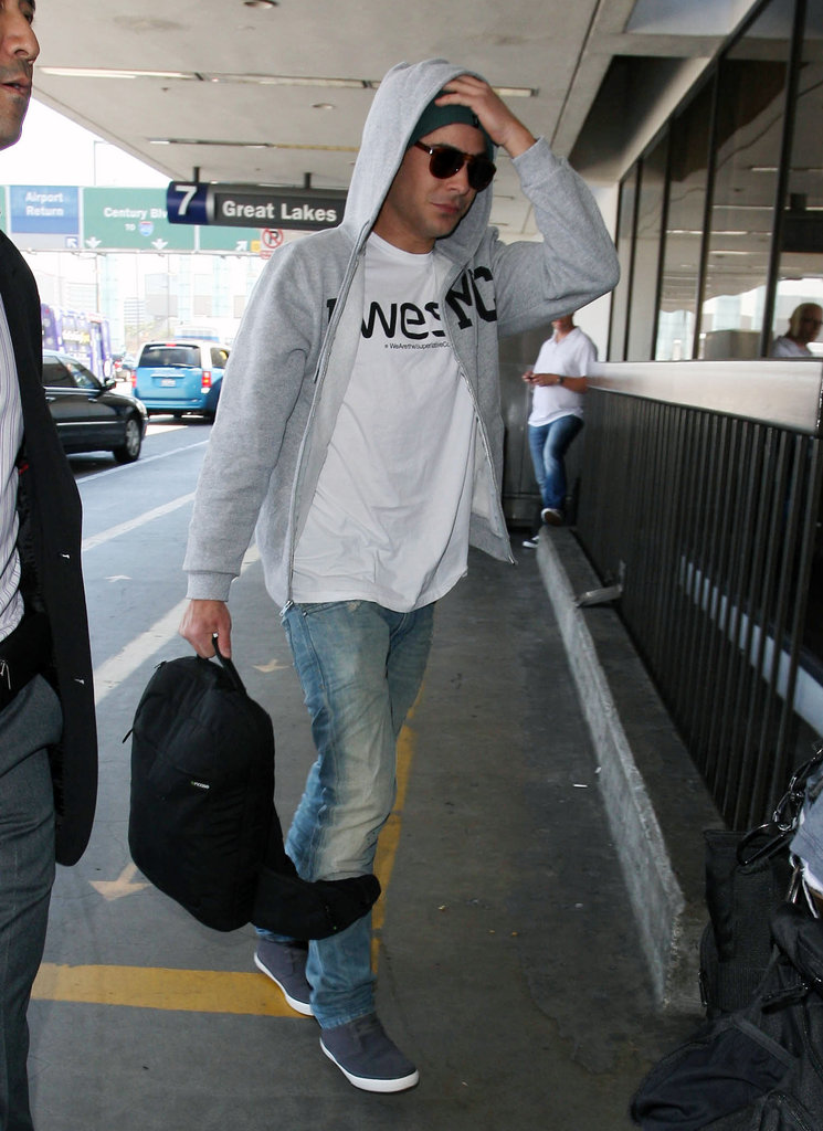 Zac Efron arrived at LAX.