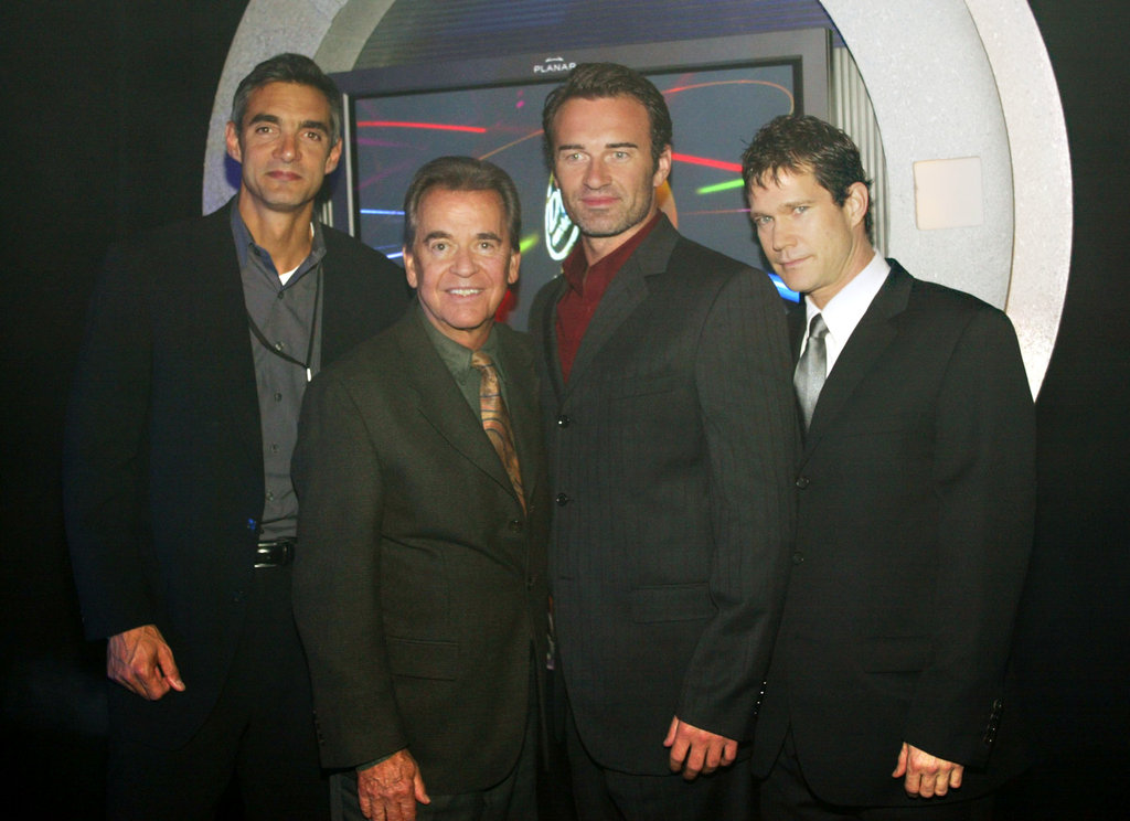 Nip/Tuck stars Julian McMahon and Dylan Walsh posed with Dick Clark at the DVD Exclusive Awards in December 2003.