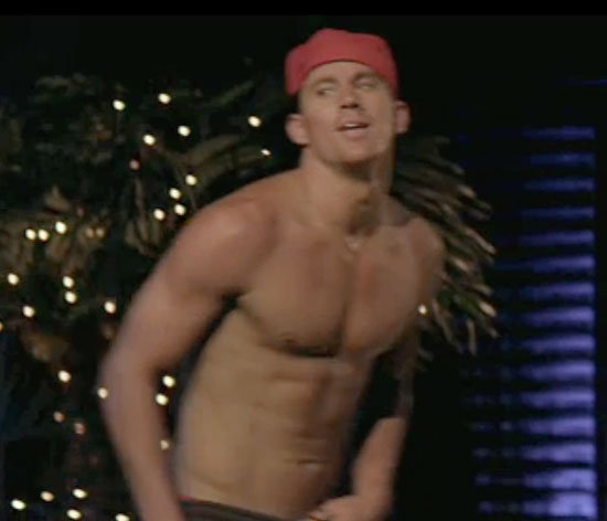 Channing Tatum flashes his abs to the crowd.