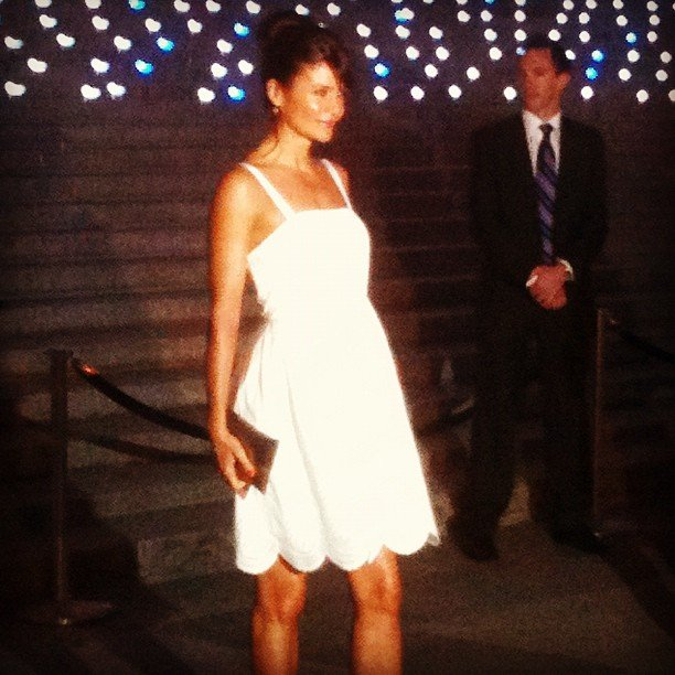 Helena Christensen posed in a pretty Spring white Marc Jacobs frock, complete with an ultra-girlie scalloped hem.