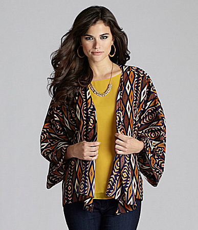 Instantly uplift a day or nighttime look with an exotic, African-esque print jacket. The open-front silhouette allows you to show off your outfit, and the billowing sleeves create a relaxed, flattering fit.  Gianni Bini Jordan Tribal-Print Jacket ($31)