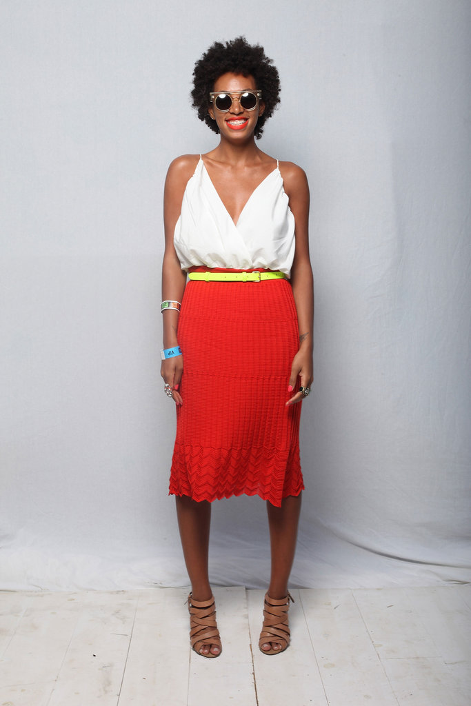 Solange Knowles offset a poppy-hued skirt with a flash of bright yellow on her belt.