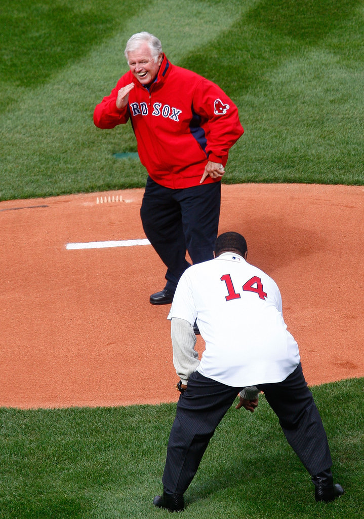 Senator Ted Kennedy prepped to throw the first pitch to Red Sox player Jim Rice before opening in April 2009.