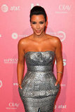 Kim Kardashian wore a silver strapless dress.