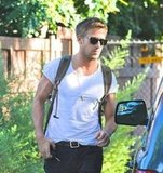 Ryan Gosling sported a tight shirt and a backpack.