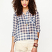 The sheer finish on this gingham find gives it a cool-girl factor you can play up with lace shorts or cutoffs.