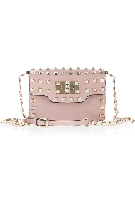 Tough studs on the most delicate shade of light pink leather, this bag will add a sophisticated edge to every look. Valentino Studded Mini Leather Shoulder Bag  ($1,795)