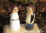 Princess Leia and Han Solo ($55) peg wedding cake toppers are too cute — just look at Leia's famous hair buns!