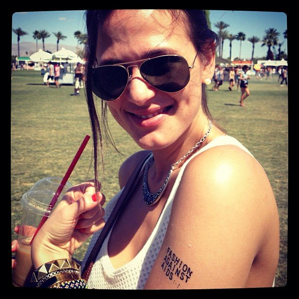 Assistant editor Hannah showed off her H&M Fashion Against AIDS tattoo (temporary, that is) while out at the festival.
