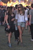 Rosie Huntington-Whiteley paired a pair of daisy cutoffs with a white oxford at Coachella's second weekend.