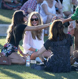 Rosie Huntington-Whiteley, in Christopher Kane for J Brand shorts, picnicked with friends in the grass while enjoying the shows at the second weekend of Coachella.