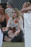 Emma Roberts relaxed in the grass at Coachella's second weekend.