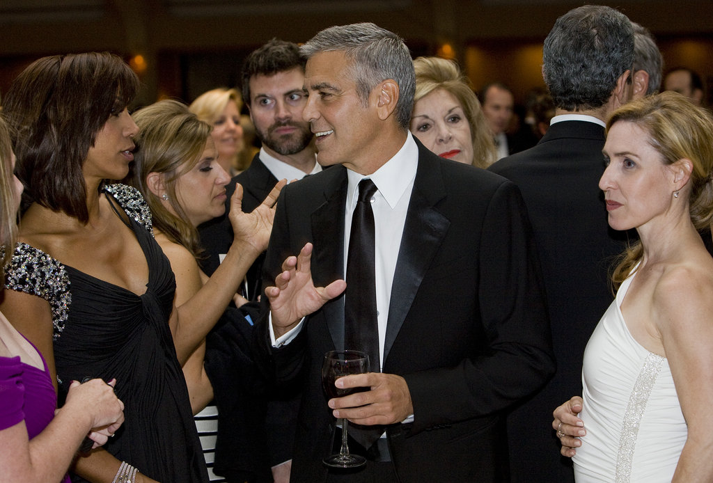 George Clooney was surrounded by ladies at the White House Correspondant's Dinner.