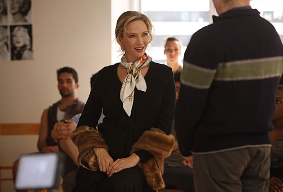 Uma Thurman's character, Rebecca, looks Parisian chic in a silk scarf tied around her neck and a fur stole.