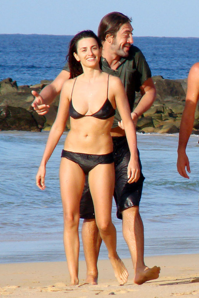 A bikini-clad Penélope Cruz and husband Javier Bardem took a walk on the beach while vacationing with friends in Brazil in July 2010.