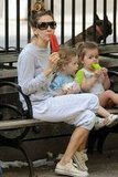 Sarah Jessica Parker cooled off with a popsicle while out with her twins Loretta Broderick and Tabitha Broderick in NYC.