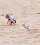 Shiloh played in the sand while Vivienne took a nap in the sand.