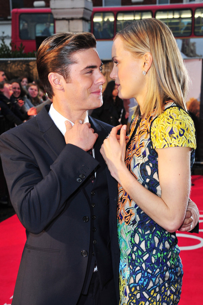 Taylor Schilling whispered to Zac Efron at the premiere of The Lucky One in London.
