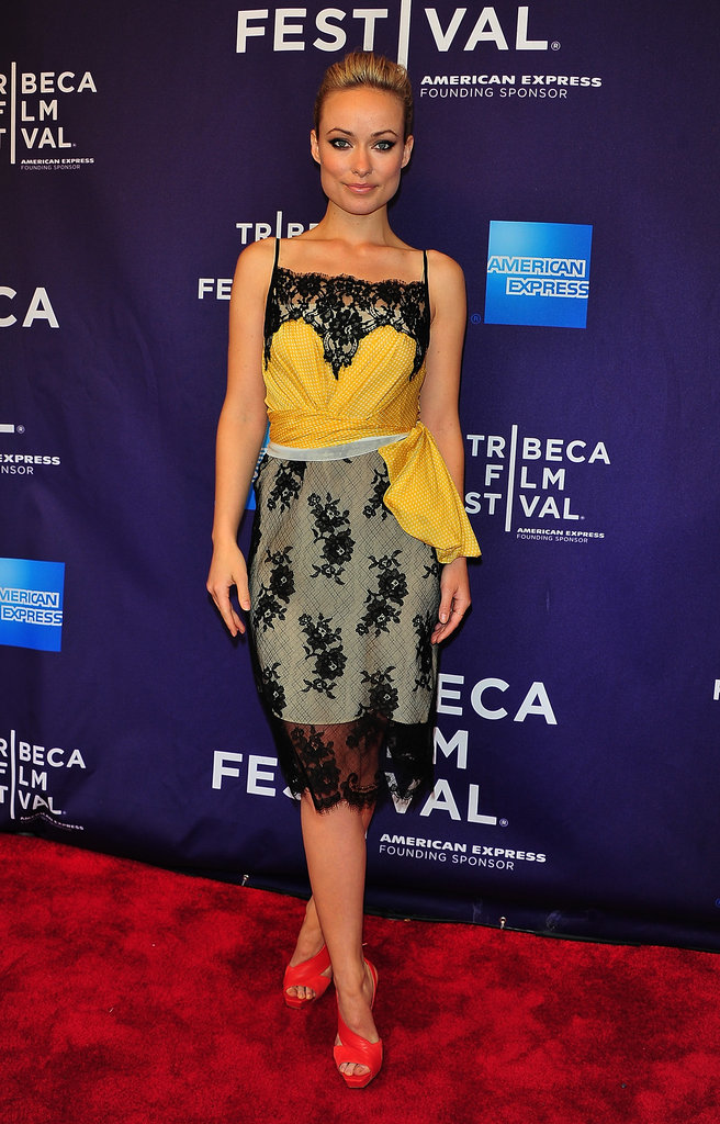 Olivia Wilde gave her Prada dress another color dimension with these strappy Aperla heels.