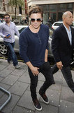 Zac Efron wore a navy blue shirt and sunglasses to BBC Radio in London.