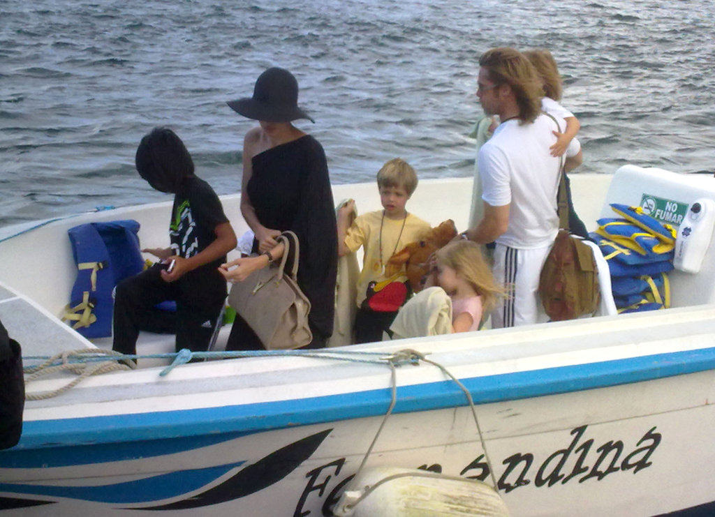 Angelina Jolie and Brad Pitt rounded up their troops while getting off of a boat at the end of their week-long vacation in the Galapagos Islands.