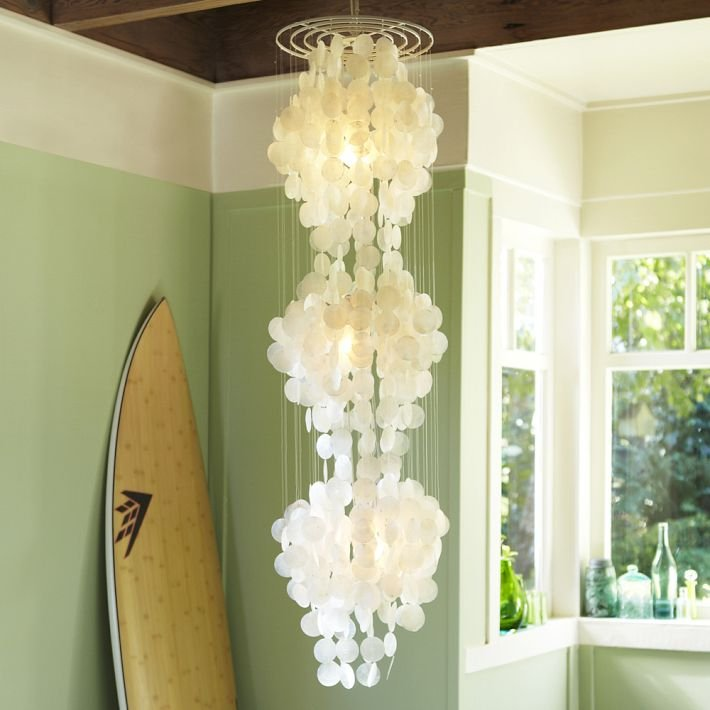 Nothing says glam coastal decor like a capiz shell chandelier. Instead of going for a classic shape, why not go all the way with a stunner like this Capiz Three Tier Chandelier ($200)?