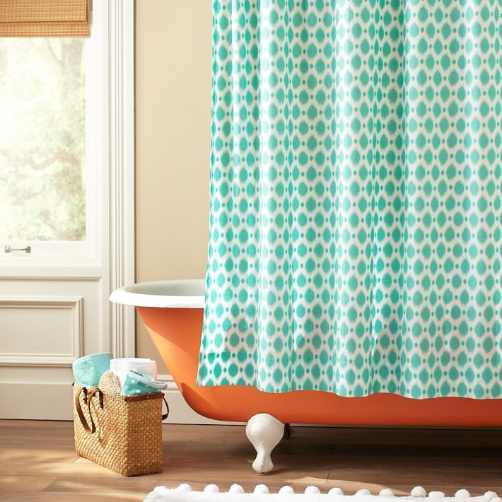 We especially love the idea of introducing pattern to the bathroom with an eye-catching shower curtain. This Ikat Dot Organic Shower Curtain ($50) does the trick.
