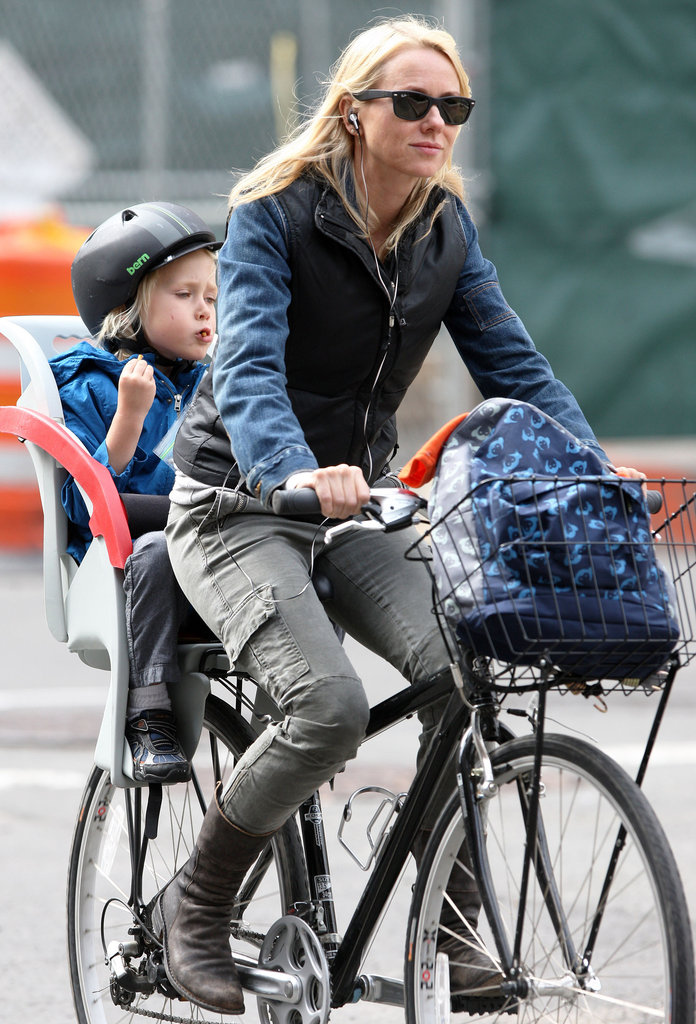 Naomi Watts kept warm in a vest and boots as she gave son Sasha Schreiber a ride through the city.