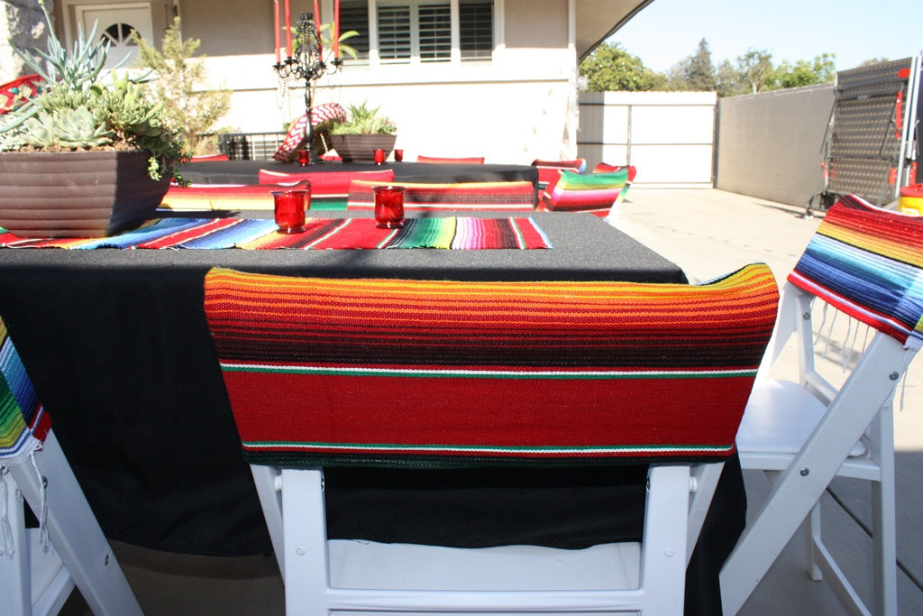 Set the celebratory mood with this Fiesta Chair Cover ($20) and a few festive props, like a sombrero or a pair of maracas.