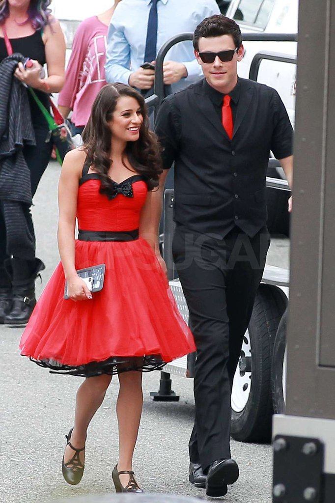 Lea Michele and Cory Monteith walked together on the set of Glee.