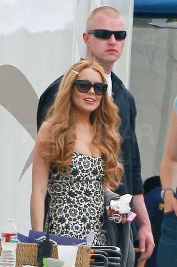 Lindsay Lohan wore shades on the set of Glee.