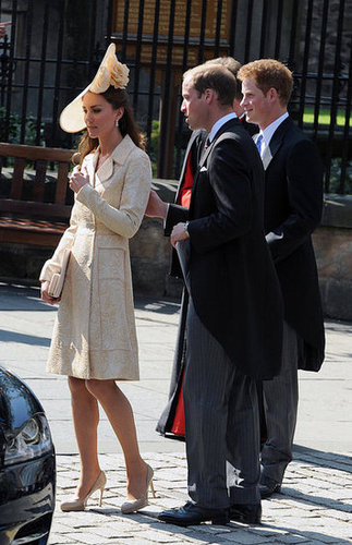 Kate wore an oversize Gina Foster hat to go with her Collette Dinnigan dress, DAY Birger et Mikkelsen jacket, and LK Bennett accessories for the July 30, 2011, nuptials of Zara Phillips and Mike Tindall with Princes William and Harry.