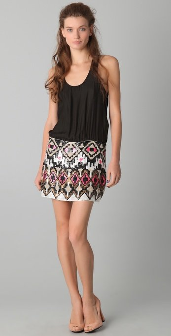 Sporty meets sexy all in one piece. The top is an easy fit racerback, the bottom is a gorgeously beaded skirt. How's that for easy styling?  Parker Sequined Racer Dress ($374)