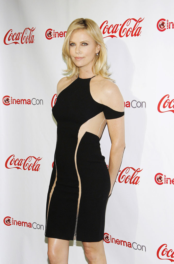 Charlize Theron wore an LBD with cutouts and nude netting to the CinemaCon awards ceremony in Las Vegas.