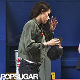 Kristen Stewart wore a green army jacket.
