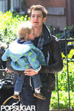 Andrew Garfield held his friend's son while walki NYC.