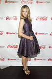 Chloe Moretz wore a metallic purple Kenzo dress with red dots to the CinemaCon awards ceremony in Las Vegas.
