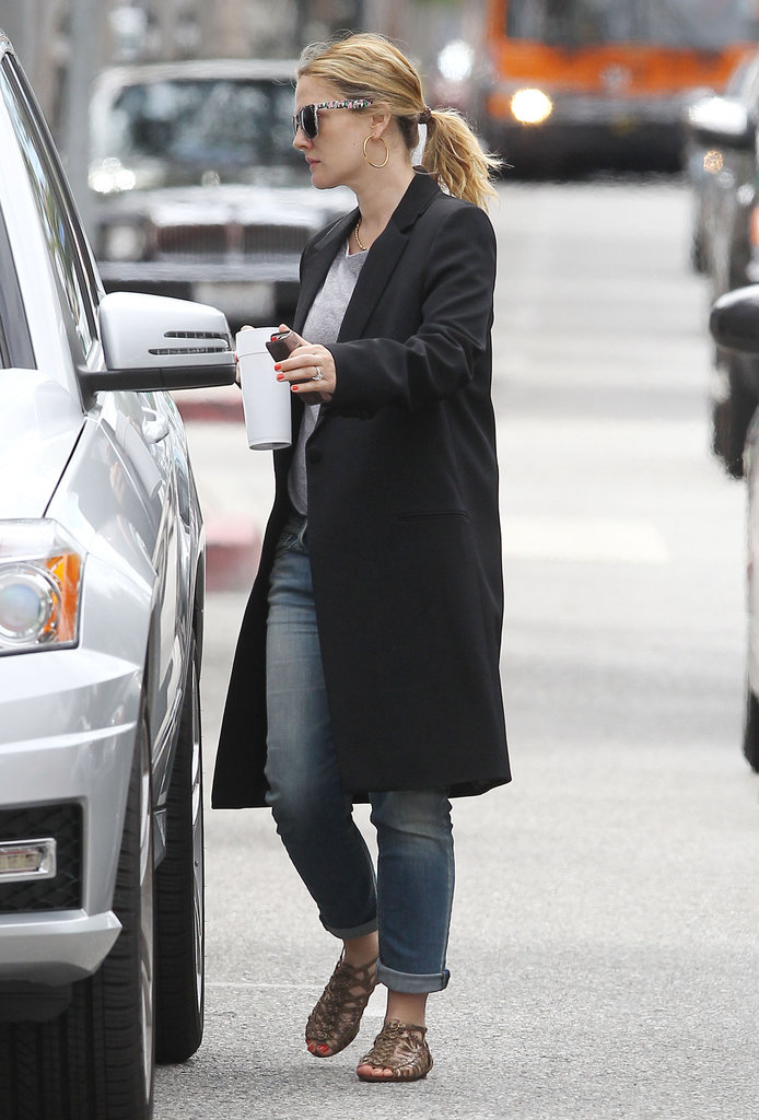 Drew Barrymore left her LA office and headed for her car in a long black jacket.