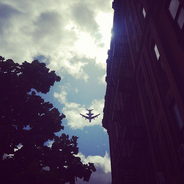Space shuttle Enterprise and 747 airplane escort seen from a Manhattan street. Source: Instagram User caromaxmusic