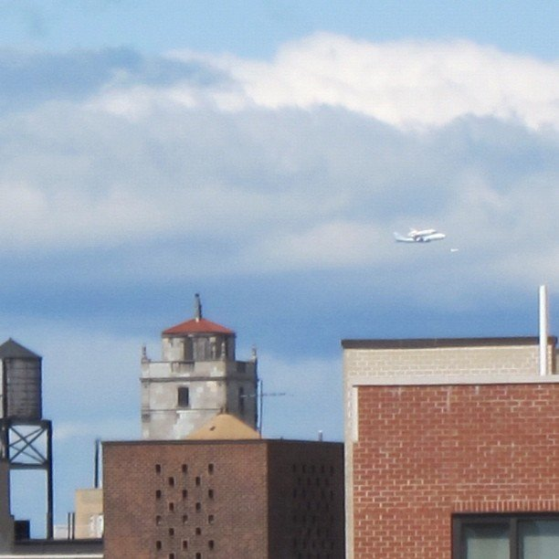 The space shuttle Enterprise travels through the Manhattan skyline. Source: Instagram User reneemudd