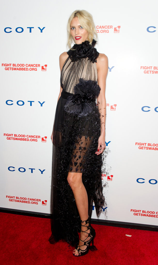 Anja Rubik channeled a more gothic sensibility in a sheer black Alberta Ferretti confection and lace-up heels.