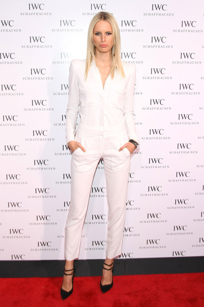 Karolina Kurkova styled an all-white ensemble with a pair of ankle-strap pumps.