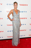 Heidi Klum glowed in a sequin and floral-adorned Temperley London gown.