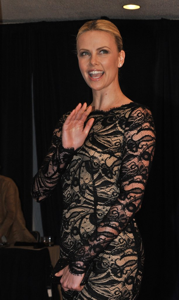 Charlize Theron waved to the camera at the White House Correspondant's Dinner.