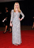 Dakota Fanning wore a long silver dress.