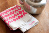 Go for a neon pattern with the Hot Pink Geometric Tea Towel ($17).