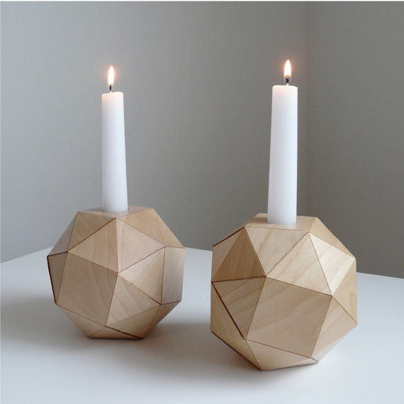 For a rounder take, try these Geometric Wooden Candlesticks ($37).