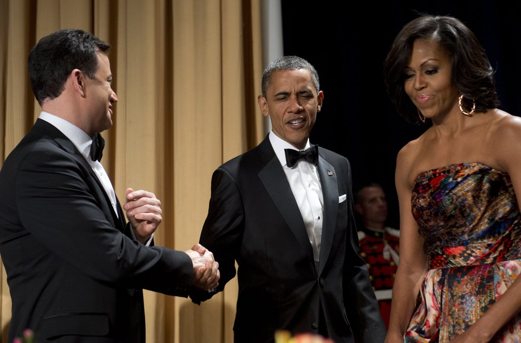 With Michelle by his side, the president shook host Jimmy Kimmel's hand.