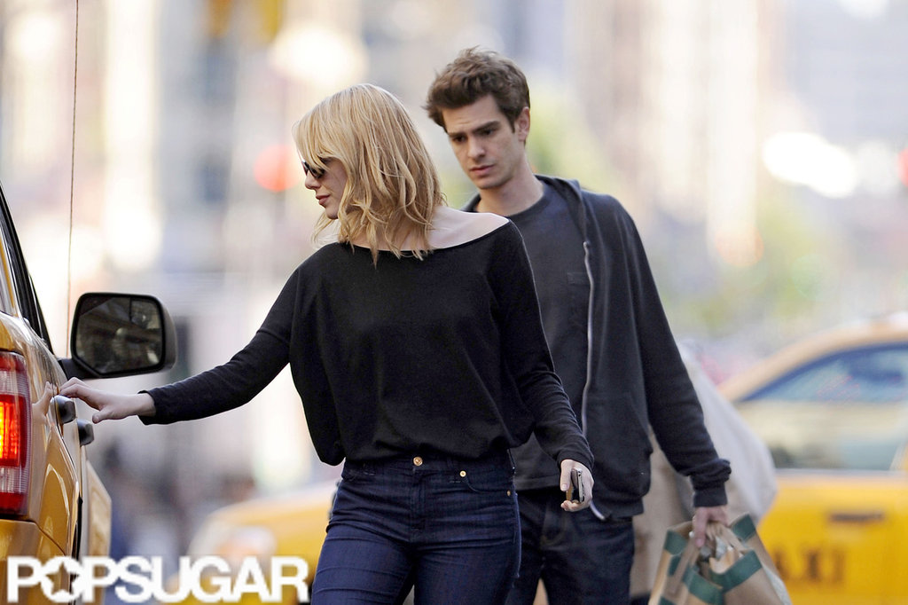 Emma Stone hailed a taxi door while Andrew Garfield carried grocery bags from Whole Foods in NYC.